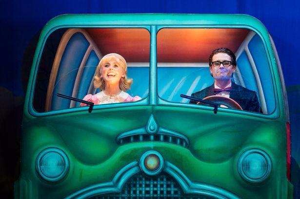 MUMBLE PIC- ROCKY Brad & Janet in car.jpg